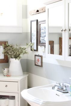 Changing the color of their bathroom stripes, was all that was needed to complete this Bathroom Mini-Makeover. You won't believe the power of new paint!!