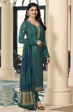 Bollywood diva prachi desai style teal designer straight cut suit online which is crafted from crepe fabric with exclusive embroidery and stone work. This latest embroidered straight cut suit comes with crepe bottom and chiffon dupatta. Lehenga Suit, Sharara Suit, Lehenga Style, Churidar Suits, Salwar Kameez, Kurti, Ladies Suits Indian, Suits For Women, Eid Outfits