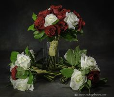 Harry Potter color themed Bride's and Bridesmaid bouquets.  Red and white roses with gold ribbon.