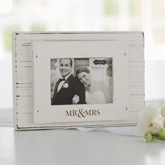 1 1/2' thick painted, distressed wood block frame features layered frame-on-frame construction with 'MR & MRS' etched sentiment. Free standing frame holds 3' x 4' photo inserted from top.