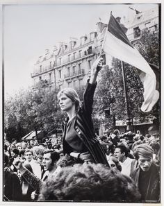Jean-Pierre Rey: Girl Waving Flag During General Strike, Paris, May 1968 LIFE's May 24, 1968 coverage of the Paris uprisings: The street battle of Paris began with student demonstrations and swiftly escalated into savage warfare. Rock-throwing bands charged up the boulevards. Police, led by the elite and detested Compagnies Républicained de Sécurité, and Gardes Mobiles, charged over cobblestone barricades the student built and attacked without restraint or discrimination. clik thru to read