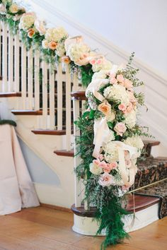 wedding staircase decoration with rose floral garland