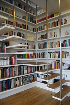 Amazing Stair Designs -                                                              Books stairs Dusseldorf, 2011  A walk-in spatial sculpture combines two flats in Dusseldorf.
