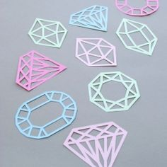 Make some paper-cut gems...perfect for garlands, mobile, gift toppers, stencils etc! (printable template included). #craftgawker
