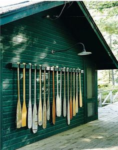 A collection of oars.  Note the antique light.