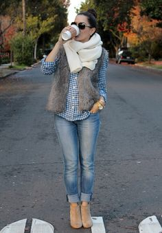 Shop this look on Lookastic:  http://lookastic.com/women/looks/sunglasses-scarf-vest-dress-shirt-watch-skinny-jeans-ankle-boots/5538  — Dark Brown Sunglasses  — Beige Knit Scarf  — Grey Fur Vest  — Navy and White Gingham Dress Shirt  — Gold Watch  — Blue Skinny Jeans  — Tan Suede Ankle Boots