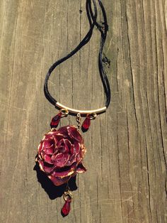 Finally getting my etsy listings up! Preserved rose necklace with gold and red crystal. This was fun to make, I don't get to work with gold that often but I really enjoyed how it turned out.