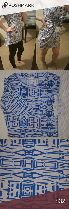 Lularoe Irma XXS- wear as shirt or dress! Beautiful blue and white pattern. Size down 1-2 sizes from your normal shirt size for best fit. 96% polyester, 4% spandex.   The Irma is so versatile. You can wear her as intended or pull it down around your chest and tie the arms for a cute beach cover up! Typically I would size up to wear it as a dress but if you are smaller chested (hey girl, me too) and don't mind it a tad shorter in the front then the xxs works just fine! Example in the cover…