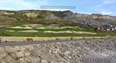 Above the Chesil cove is a land sculpture known as Chiswell Earthworks. Created by John Maine RA, between 1986 and 1993