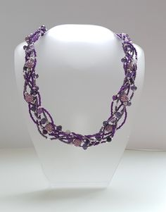 Braided necklace with seed beads, glass beads and shamballa beads. 6 strands on jewellry wire.