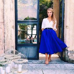 Eleonora Sebastiani in a white button-up + cobalt blue midi skirt + sandals