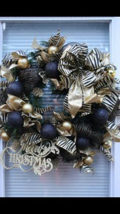 Black and zebra print themed Christmas wreath for the holidays.