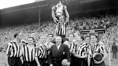 Jimmy Scoular lifts the FA Cup aloft in 1955 for Newcastle United