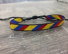 adjustable unisex bracelet woven in miyuki with the colors of the Colombian flag. Loom, Beading, Craft, Bracelets, Diy, Jewelry, Necklaces, Anklets, Making Yarn Bracelets