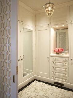 Massuco-Warner-Miller's sleek dressing room features a beautiful carved custom pocket door