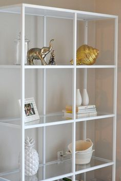 Ikea - Vittsjo shelving with glass is quite airy but don't know if you need this much or want it tall?