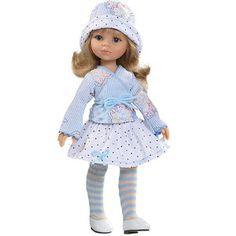 Carla est une ravissante poupée mannequin vêtue dune tenue d'hiver très à la mode.   Elle porte une jupe à pois superposée sur des leggings rayés, un cache coeur, un élégant chapeau assorti, ainsi que des chaussures vernies blanches.   Détail chic : Cette poupée est délicatement parfumée !
