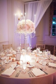 Tall crystal candelabra with roses and hydrangeas but with the blue/gray color as well