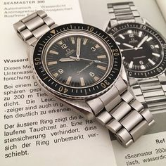 """REPOST!!!  Omega Seamaster 300 and its corresponding catalog published in the mid 60s for German clients. Surprisingly, the """"300"""" is missing after the """"Seamaster"""" writing on the dial of the watch pictured in the catalog.  repost 
