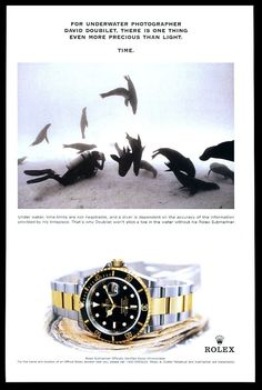 1999 Rolex Submariner watch scuba diver diving with seals photo print ad