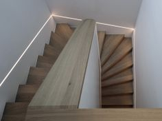 Residence in Lugano is a minimalist house located in Lugano, Switzerland, designed by Volpatohatz. A private client commissioned VOLPATOHATZ to add another level and fully renovate an existing villa f Lugano, Stair Lighting, Linear Lighting, Lighting Design, Home Entrance Decor, House Entrance, Small Staircase, Staircase Design, Stair Detail