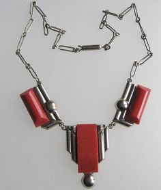 Art Deco red galalith & chrome necklace with balls.  Photograph by Gillian Horsup.
