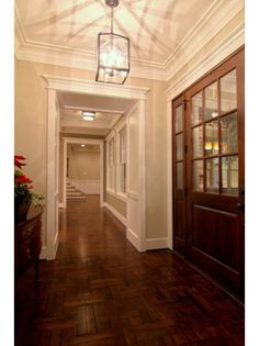 Sherwin Williams Accessible Beige on walls with dark wood floors and white trim.