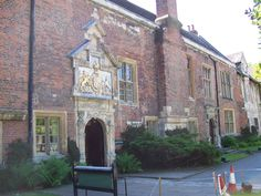 The King's Manor, in York, UK. Since 1963, it has been occupied by the University of York. See plaque on this board.