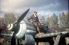 A pilot poses on top of his Focke-Wulf FW-190 (Date and location unknown) ~ BFD