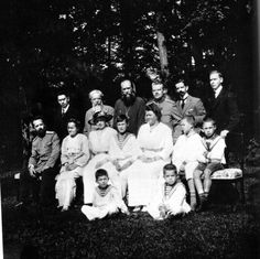 "Left to right center row: Dr. Derevenko (far left) (possibly Sophie ""Isa"" Buxhoeveden next to Alexei) Alexei. Back row Third from right Father (Vasiliev), Pytor Vaslilievich Petrov, French tutor Pierre Gilliard, English Tutor Sindey Gibbes."