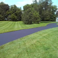 Freshly Sealed Driveway and Some Green Grass....#roc #driveway #sealcoating #asphalt