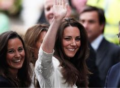 Kate Middleton waves to fans in London a day before the big royal weddimg