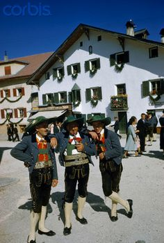 Men in square wear traditional clothing to honor patron saint - Ortisei 1951  #TuscanyAgriturismoGiratola