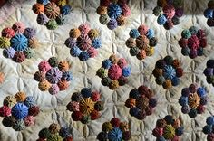 Upside down yo-yo quilt: neat idea! Maybe not for baby quilt.