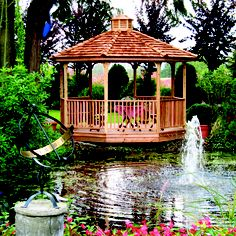 The octagon gazebo on the edge of the pond...so tranquil!   visit: cedarshed.com