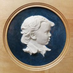 Coloured earthenware in a turned frame Wall Panel Carving Sculpture Statue #sculpture by #sculptor Tristan MacDougall titled: 'Bas-relief Portrait of a Boy (ceramic custom Bespoke Commission Panel)' #art