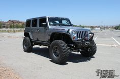 Silver Fox - 2013 10th Anniversary Rebelcon: Front-left view of the customized Jeep.