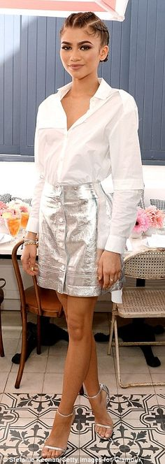 Zendaya attended Glamour's Game Changers Lunch in 2016 wearing a button-down blouse and metallic silver skirt with her silver Stuart Weitzman nudist heels. Mode Zendaya, Zendaya Style, Zendaya Outfits, Zendaya Hair, Zendaya Coleman, Glamour, Stuart Weitzman, Silver Skirt, Vogue