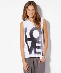 via @stylelist | To DIY: iconic LOVE shirt, but add a cross to the O. DIY with contact paper stencil and spray paint.