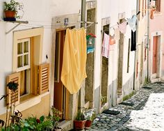 Portugal Photography - Laundry Room Art Print - Lisbon Street Photograph Portuguese Decor Rustic European Decor Travel Photo Yellow by VitaNostra on Etsy https://www.etsy.com/listing/74024820/portugal-photography-laundry-room-art