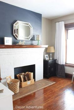 Painting a Hale Navy Accent Wall above the fireplace in our Old House Foyer: