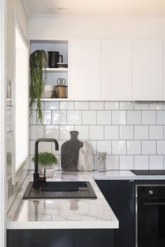 Kaboodle kitchen with subway tiles and matt black tapware and sink. Life Kitchen, Home Decor Kitchen, Kitchen Interior, New Kitchen, Kitchen Design, Kitchen Island, Black Kitchens, Home Kitchens, Kaboodle Kitchen Bunnings