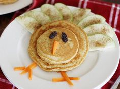 Your family will give thanks for our turkey-shaped Gobble Gobble pancakes made with Bisquick, molasses, cinnamon and ginger. Add apple slices for the feathers, raisins for eyes and carrot sticks for the beak and legs. Thanksgiving Treats, Holiday Treats, Thanksgiving Turkey, Hosting Thanksgiving, Holiday Fun, Cute Food, Good Food, Yummy Food, Fall Recipes