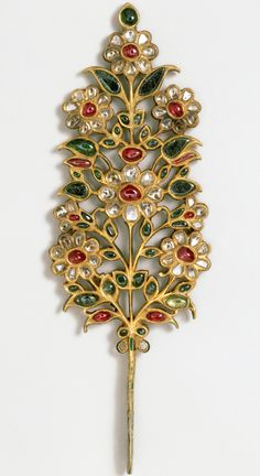 Turban ornament, India or Pakistan, early 18th century, set with rubies, emeralds, pale beryls and diamonds.