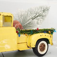 Decorate vintage toy trucks for the Christmas holiday