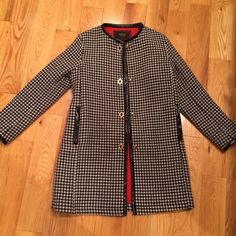Coach Houndstooth Coat Coach houndstooth print / leather lining coat! With gold buckles in the front - and beautiful red lining inside. Worn only few times so in perfect condition. Leather belt just in the back which gives a slimming silhouette! Coach Jackets & Coats Pea Coats