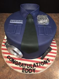 Eddy's Police Academy Graduation. White cake with strawberry filling.