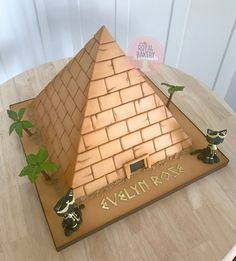 Ancient Egyptian pyramid cake with palm trees and black cats.