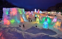 People visit the Chitose-Lake Shikotsu Ice Festival illuminated by colorful light to produce a fantastic world in Chitose on January 24, 2014. The annual ice festival will be held until February 16. (Photo by Kazuhiro Nogi/AFP Photo)