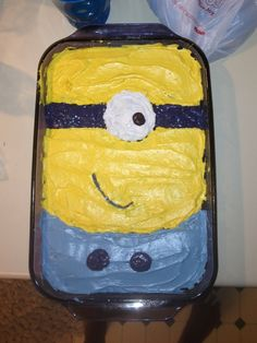Despicable Me cake!  So easy to make - I used white whipped frosting and just colored it with food dye. My stepson loves it!  I plan to put the candles at the top where the crazy hair pokes out.